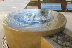 This decorative concrete fountain at the Clovis Community Medical Center was installed using Bomanite Integral Color paired with a smooth trowel finish and the peaceful aesthetic is a perfect reminder that every moment matters.