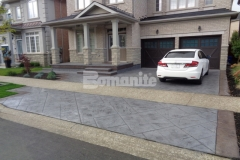 Our colleague Bomanite Toronto skillfully installed this stunning stamped concrete to replace the previously outdated driveway and front porch entrance for a Burlington, Ontario homeowner, utilizing the Bomacron Yorkshire Stone imprint pattern to create a cohesive design that won them the Silver Award in 2017 for Best Bomanite Imprint Project under 12,000 SF.