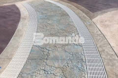 A meandering brook concept was desired for the hardscape surrounding the Castaway Island water feature at Canobie Lake Park and our colleague, Harrington Bomanite, used Bomanite Imprint Systems to achieve this unique design, which includes serpentine drains that infiltrate storm water and minimize runoff while accentuating the decorative concrete decking.