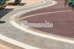 This stamped concrete decking features Bomanite Imprint Systems and includes multiple Bomacron patterns that integrate perfectly to add beautiful contrast and dimensional detail throughout the Castaway Island water feature in Canobie Lake Park.