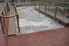 Bomanite Bomacron in Medium Ashlar Slate was chosen for this space to create a decorative concrete pedestrian bridge and wheelchair access ramps, adding durability and a beautiful design aesthetic to this outdoor pavilion.