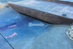 The installation of Bomanite Imprint Systems and the Bomacron 12-inch Boardwalk pattern at Inspiration Playground by our associate Belarde Company resulted in this stamped concrete bridge with replicated wooden planks that showcase attention to detail and expert installation.