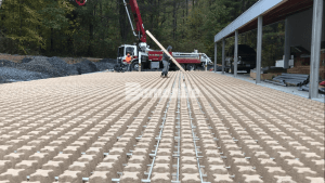 A view of the Grasscrete Pervious Concrete single-use Molded Pulp Formers in place with rebar as reinforcement in both directions before a crew begins pouring concrete.