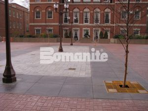 Plaza view complete with trees, pole lights, and drainage system installed by Connecticute Bomanite Systems using Bomanite Imprint Systems with Bomanite Basketweave Brick pattern and Bomacron Medium Ashlar Slate pattern.