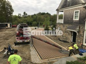 Concrete pour for Bomanite Grasscrete Pervious Concrete Systems onto the moulded pulp formers, being installed by Premier Concrete Construction at an Essex county estate.