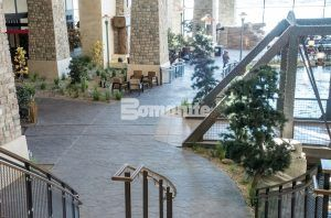 The atrium of the Grand Lodge at the Gaylord Rockies Resort and Convention Center featuring Bomanite Imprint and Bomanite Sandscape Texture decorative concrete in Aurora, CO installed by Colorado Hardscapes.
