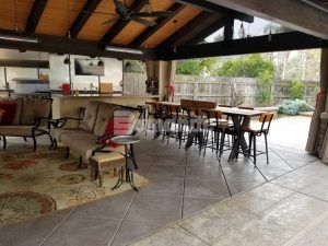 Cabana seating area features the Bomanite Exposed Aggregate Antico Process System decorative concrete with sawcuts to provide that element of separation and design at a private residence in Fresno, CA, installed by Heritage Bomanite.