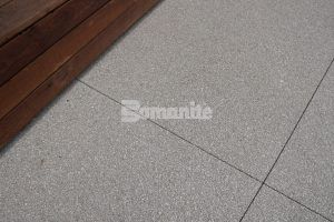 Close up of Bomanite Revealed Exposed Aggregate decorative concrete at Flight At Tustin Legacy in Tustin, CA, installed by Bomel Construction.