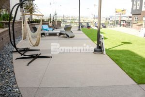 Seating area at CoLab Student Living Housing Community in Denver featuring Bomanite Exposed Aggregate Systems, Bomanite Toppings Systems and Board Formed Concrete by Colorado Hardscapes.