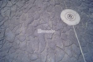 Close up of a custom Bomanite Imprint System Pattern Chipped Shale decorative concrete at the Owasso Redbud Festival Park in Owasso, OK, installed by Bomanite of Tulsa.