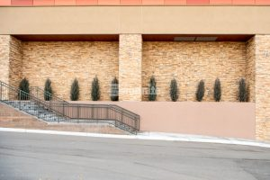 Outside stairway at a retaining wall featuring Bomanite Topping Systems Micro-Top ST decorative concrete at The Charles Schwab Conference Center at Ridgegate in Lone Tree, CO, installed by Colorado Hardscapes.