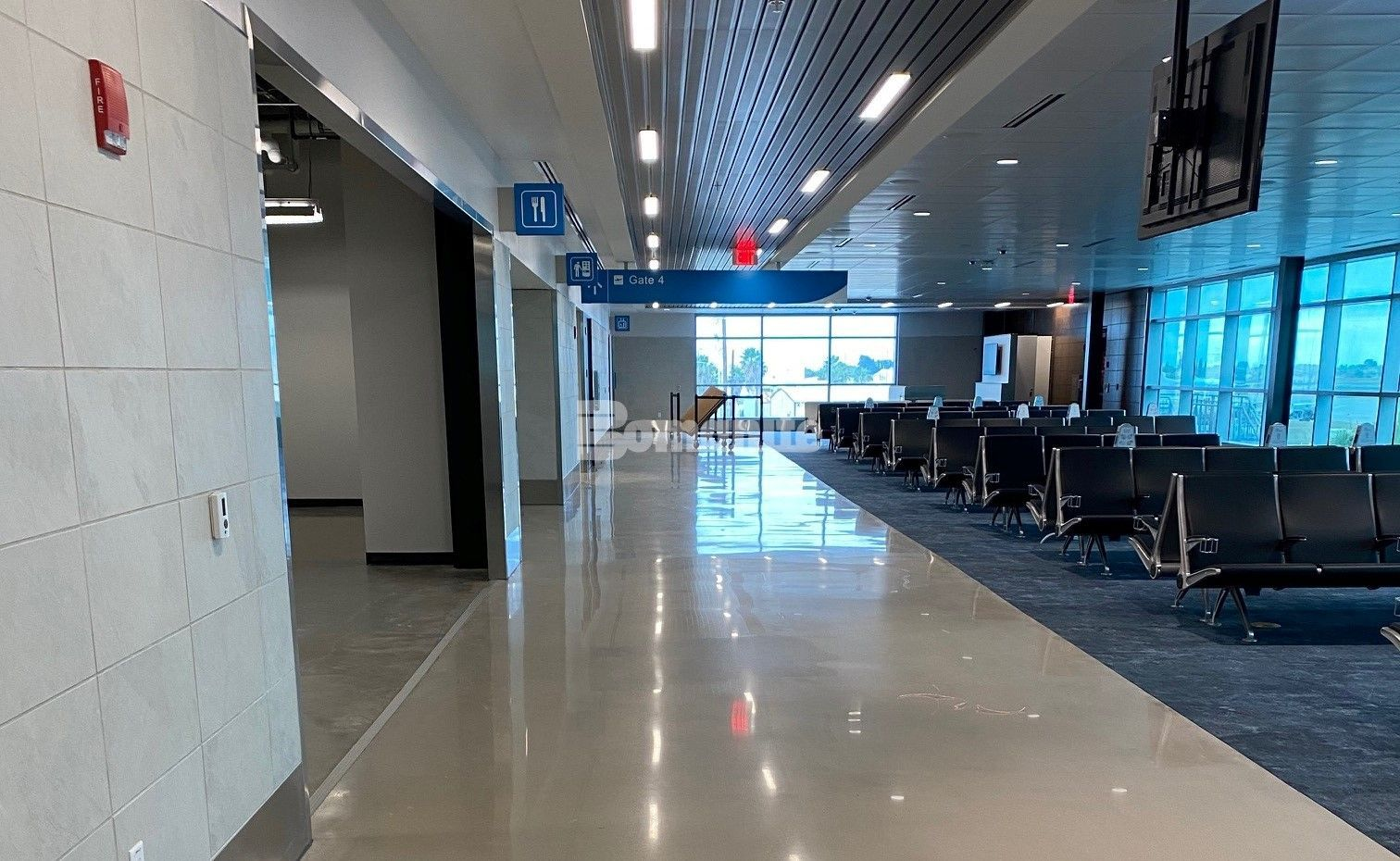 Gate 4 at the newly renovated Brownsville South Padre Island International Airport in Brownsville, TX, using Bomanite Custom Polishing Modena SL System decorative concrete flooring installed by Texas Bomanite.